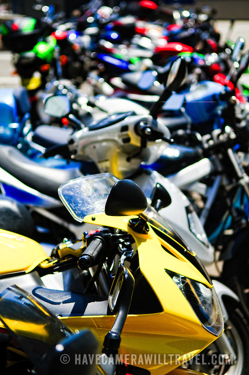 Rows of motorbikes parked on the street in downtown Sydney