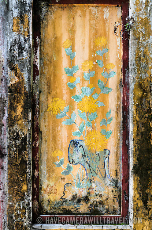 A weathered painting at the Imperial City in Hue, Vietnam. A self-enclosed and fortified palace, the complex includes the Purple Forbidden City, which was the inner sanctum of the imperial household, as well as temples, courtyards, gardens, and other buildings. Much of the Imperial City was damaged or destroyed during the Vietnam War. It is now designated as a UNESCO World Heritage site.