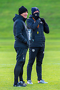 (LtoR) Heart of Midlothian assistant manager, Lee McCulloch  and Heart of Midlothian manager Robbie Neilson are wrapped up against the weather during the Heart of Midlothian press conference and training session at Oriam Sports Performance Centre, Edinburgh, Scotland on 23 November 2020.