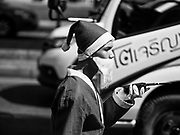 16 DECEMBER 2017 - BANGKOK, THAILAND: Parking attendant dressed as Santa Claus at Emporium, a high end shopping mall in Bangkok. Although Buddhist majority Thailand doesn't celebrate the religious aspects of Christmas, the commercial aspects of the holiday are widely celebrated in Thailand's larger cities.      PHOTO BY JACK KURTZ