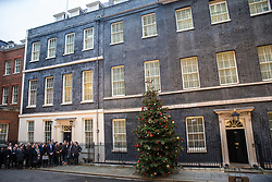 London, UK. 13 December, 2019. Downing Street staff, including adviser Dominic Cummings, listen to Prime Minister Boris Johnson making an address to the nation outside 10 Downing Street after the Conservative party won the general election with a majority in the House of Commons of 80.