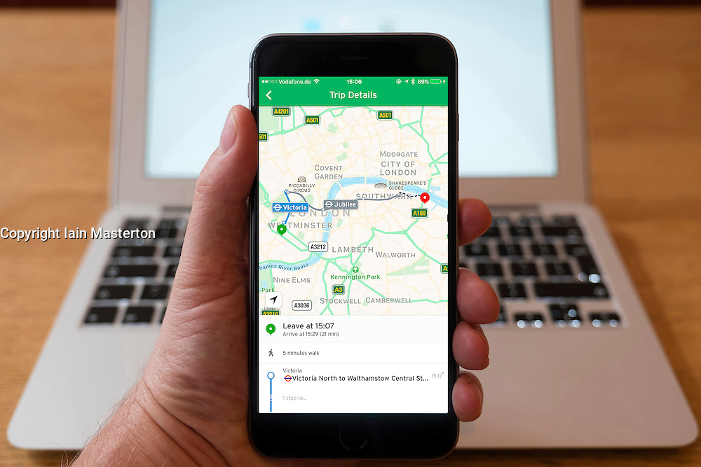 Using iPhone smartphone to display Citymapper route planning app in London