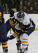 While another fight is going on near UNC's goal, NAU's forward Corey Briody (Sr.) goes at it with UNC's forward Mitchell Bailey during the 3rd period, Saturday Jan. 30, 2016. With NAU up 6-2 at this point, UNC can be seen to be really frustrated as they try to rally the troops to try to close the gap between NAU. (Photo by David Carballido-Jeans)