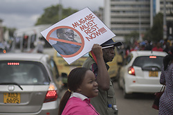 November 18, 2017 - Harare, Zimbabwe - People cheer a passing Zimbabwe Defense Force military vehicle during a demonstration demanding the resignation of Zimbabwe's president on November 18, 2017 in Harare. Zimbabwe was set for more political turmoil November 18 with protests planned as veterans of the independence war, activists and ruling party leaders called publicly for President Robert Mugabe to be forced from office. (Credit Image: © Belal Khaled/NurPhoto via ZUMA Press)