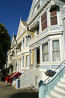 "Victorians at Alamo Square - Painted Ladies is a term used for Victorian and Edwardian buildings painted in three or more colors that enhance their architectural details.  About 48,000 houses in the Victorian and Edwardian styles were built in San Francisco between 1849 and 1915 with the change from Victorian to Edwardian occurring on the death of Queen Victoria in 1901, and many were painted in bright colors.  One of the best known groups of ""Painted Ladies"" is the row of Victorian houses on Steiner Street bordering Alamo Square park in San Francisco. This block appears very frequently in media photographs of the city."