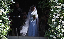 © Licensed to London News Pictures. 19/05/2018. London, UK.   Meghan Markle, The Duchess of Sussex wearing a veil as she leaves St George's Chapel in Windsor Castle following her wedding ceremony to PRINCE HARRY, Duke of Sussex. . Photo credit: LNP
