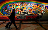 """A man walks by the """"Children of the World Dream Peace"""" mural at Denver International Airport outside Denver, Colorado U.S. November 3, 2017.  REUTERS/Rick Wilking"""
