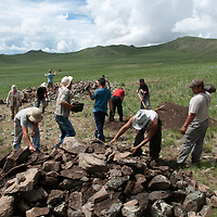 MONGOLIA. Smithsonian Museum archaeology team led by Dr. Bruno Frohlich unearths 2700+ year-old, khirigsur burial mounds at site above distant Delger River Valley, near Muren. <br /> <br /> #MS0702_060707_0109.NEF