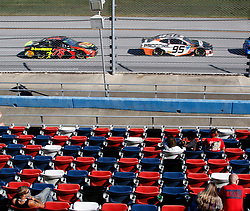 October 14, 2018 - Talladega, AL, U.S. - TALLADEGA, AL - OCTOBER 14:  The cars of #78: Martin Truex Jr., Furniture Row Racing, Toyota Camry Bass Pro Shops/5-hour ENERGY and #95: Regan Smith, Leavine Family Racing, Chevrolet Camaro Procore pass in front of empty grandstands during the runinng of the 1000Bulbs.com500 on Sunday October 14, 2018 at Talladega SuperSpeedway in Talladega Alabama (Photo by Jeff Robinson/Icon Sportswire) (Credit Image: © Jeff Robinson/Icon SMI via ZUMA Press)