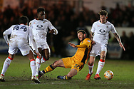 Sean Rigg of Newport county © is fouled by Pelly Ruddock Mpanzu (17) of Luton Town.EFL Skybet football league two match, Newport county v Luton Town at Rodney Parade in Newport, South Wales on Tuesday 21st March 2017.<br /> pic by Andrew Orchard,  Andrew Orchard sports photography.