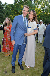 MARY CLARE ELLIOT and BEN ELLIOT at the Quintessentially Foundation and Elephant Family 's 'Travels to My Elephant' Royal Rickshaw Auction presented by Selfridges and hosted by HRH The Prince of Wales and The Duchess of Cornwall held at Lancaster House, Cleveland Row, St.James's, London on 30th June 2015.