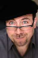 Craig Newmark, founder of Craigslist.org, sits in the stairwell at the Craigslist headquarters in San Francisco, Calif. Monday morning, March 26, 2007. Craiglist.org is an internationally known and utilized website for classified advertisements and community forums..Photo by Erin Lubin/WpN