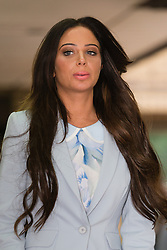 © Licensed to London News Pictures. 21/07/2014. London, UK. Tulisa Contostavlos reads a statement to the press as she leaves Southwark Crown Court on 21st July 2014 after the case against her was thrown out. Photo credit : Vickie Flores/LNP