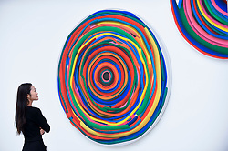 """© Licensed to London News Pictures. 12/09/2018. LONDON, UK. A staff member views """"Mandala No. 16 / Target IV./"""" by Karel Stedry (Czech Republic) at the preview of START, a contemporary art fair comprising eclectic works from a variety of international emerging artists.  The fair takes place at the Saatchi Gallery in Chelsea 13 to 16 September 2018.  Photo credit: Stephen Chung/LNP"""