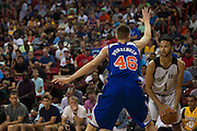 Kristaps Porzingis #46 of the New York Knicks defends against the San Antonio Spurs during an NBA Summer League game in Las Vegas, Nevada on July 11, 2015. (Cooper Neill for The New York Times)