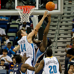 December 21, 2011; New Orleans, LA, USA; New Orleans Hornets power forward Jason Smith (14) defends as Memphis Grizzlies power forward Zach Randolph (50) shoots during the second quarter of a game at the New Orleans Arena.   Mandatory Credit: Derick E. Hingle-US PRESSWIRE