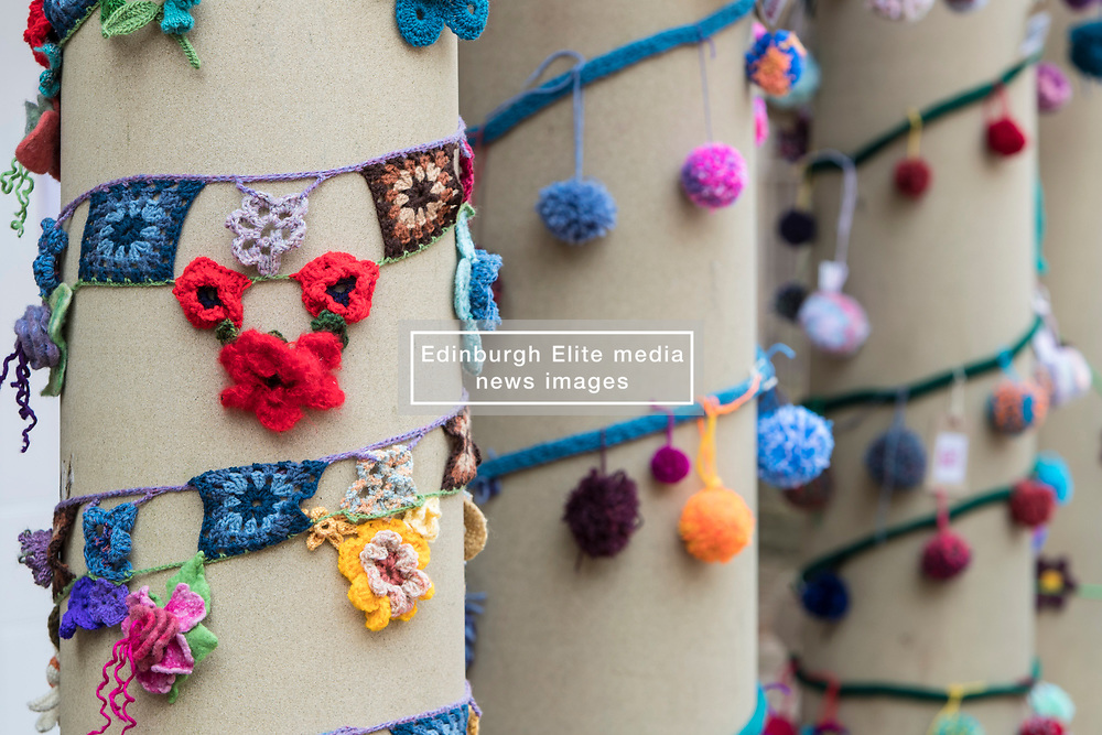 Yarnbombing during the Scotland-wide World Heritage Day festivities. Six unique events, coordinated by Dig It! 2017, celebrated Scotland's six World Heritage Sites as part of the 2017 Year of History, Heritage and Archaeology. <br /> <br /> Pictured: Pom-poms and 'Granny square' bunting on the columns of the New Lanark Institute