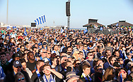 Brighton fans look on at the stage during the Brighton & Hove Albion Football Club Promotion Parade at Brighton Seafront, Brighton, United Kingdom on 14 May 2017. Photo by Phil Duncan.