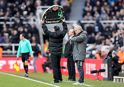 Four minutes of extra time is added on in the second half during the Premier League match at St James' Park, Newcastle.