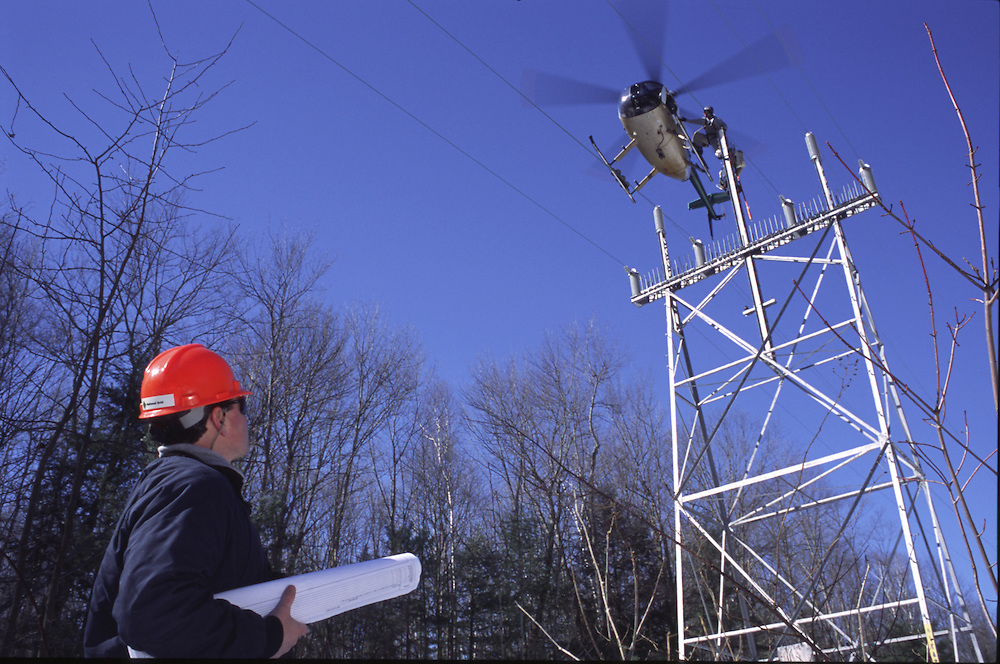 Repairing power lines with help using a helicopter.