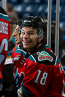 KELOWNA, CANADA - NOVEMBER 29: Carsen Twarynski #18 of the Kelowna Rockets smiles on the bench after scoring this third goal and the hat trick against the Prince George Cougars on November 29, 2017 at Prospera Place in Kelowna, British Columbia, Canada.  (Photo by Marissa Baecker/Shoot the Breeze)  *** Local Caption ***