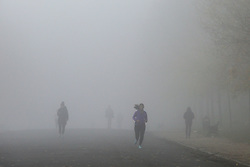 © Licensed to London News Pictures. 05/11/2020. London, UK. Runners in dense fog in Finsbury Park, north London on the first day of the COVID-19 second national lockdown. Photo credit: Dinendra Haria/LNP