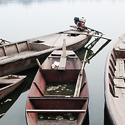 Wooden boats moored on West Lake (Ho Tay) in Hanoi, Vietnam.