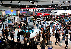 View of crowds at Peugeot display at Paris Motor Show 2010