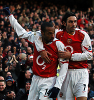Photo: Javier Garcia/Back Page Images<br />Arsenal v Fulham, FA Barclays Premiership, Highbury, 26/12/04<br />Thierry Henry celebrates his opener with Robert Pires