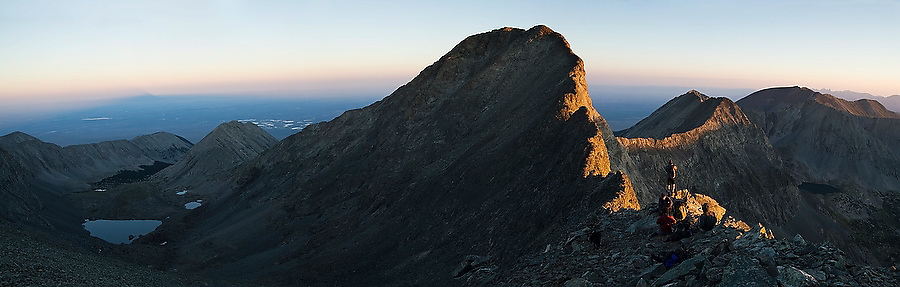 Climbers enjoy the sunrise from the saddle between Blanca and Ellingwood Peaks, both fourteeners, in the Sangre de Cristo Mountains, Colorado on July 16, 2006.