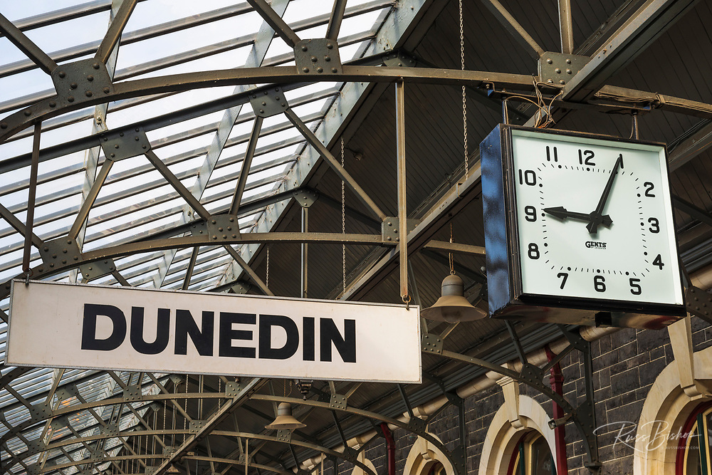 Clock and town sign at the Dunedin Railway Station, Otago, South Island, New Zealand