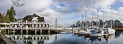 Vancouver Rowing Club reflection in Coal Harbour, BC, Canada. This panorama was stitched from 3 overlapping images.