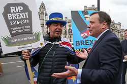 © Licensed to London News Pictures. 27/03/2019. London, UK. British businessman, Arron Banks speaks with Steve Bray, an anti-Brexit activist outside Houses of Parliament.<br /> Later today the MPs will votes on series of indicative votes on alternatives to Prime Minister Theresa May's Brexit deal. Photo credit: Dinendra Haria/LNP