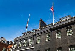London, June 19th 2017. Workers lower the flags at Downing Street to half mast in the wake of the Finsbury Park attack which left one dead and ten injured after a van was driven into Muslim worshipers. The right hand flag commemorates Armed Forces Day.