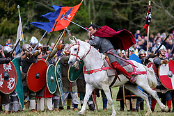 © Licensed to London News Pictures. 16/10/2016. East Sussex, UK. A re-enactor playing Duke of Normandy charges against shield wall of England as the Battle of Hastings gets under way in East Sussex to mark the 950th anniversary of the defeat of King Harold by William of Normandy in a weekend long event on Sunday, 16 October 2016.  Photo credit: Tolga Akmen/LNP