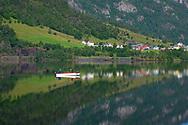 Fishermen in a small boat on Lake Granvinvatnet, Hordaland, Vestlandet, Norway, Europe