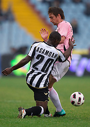 Kwadwo Asamoah of Udinese vs Armin Bacinovic of Palermo during football match between Udinese Calcio and Palermo in 8th Round of Italian Seria A league, on October 24, 2010 at Stadium Friuli, Udine, Italy.  Udinese defeated Palermo 2 - 1. (Photo By Vid Ponikvar / Sportida.com)