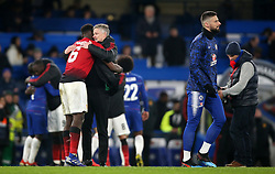 Manchester United's Paul Pogba (left) and Manchester United interim manager Ole Gunnar Solskjaer react after the final whistle during the FA Cup fifth round match at Stamford Bridge, London.