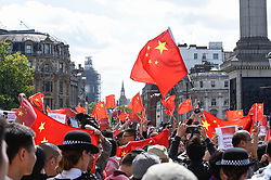 """© Licensed to London News Pictures. 17/08/2019. LONDON, UK.  Pro China demonstrators in Trafalgar Square take part in a counter protest against a solidarity rally for the people of Hong Kong.  Similar """"Global Solidarity with Hong Kong"""" rallies are taking place worldwide as protests in the former British colony enter their tenth week demanding democratic reforms and a halt to police brutality.  Photo credit: Stephen Chung/LNP"""