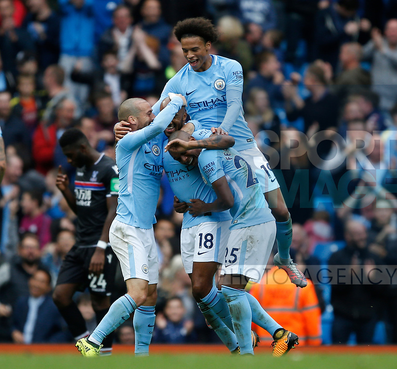 Fabian Delph of Manchester City is mobbed after scoring the fifth goal during the premier league match at the Etihad Stadium, Manchester. Picture date 22nd September 2017. Picture credit should read: Simon Bellis/Sportimage