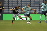 Millwall defender Murray Wallace  (3)  and Leicester City Midfielder Marc Albrighton (11) battles for possession during the EFL Cup match between Millwall and Leicester City at The Den, London, England on 22 September 2021.