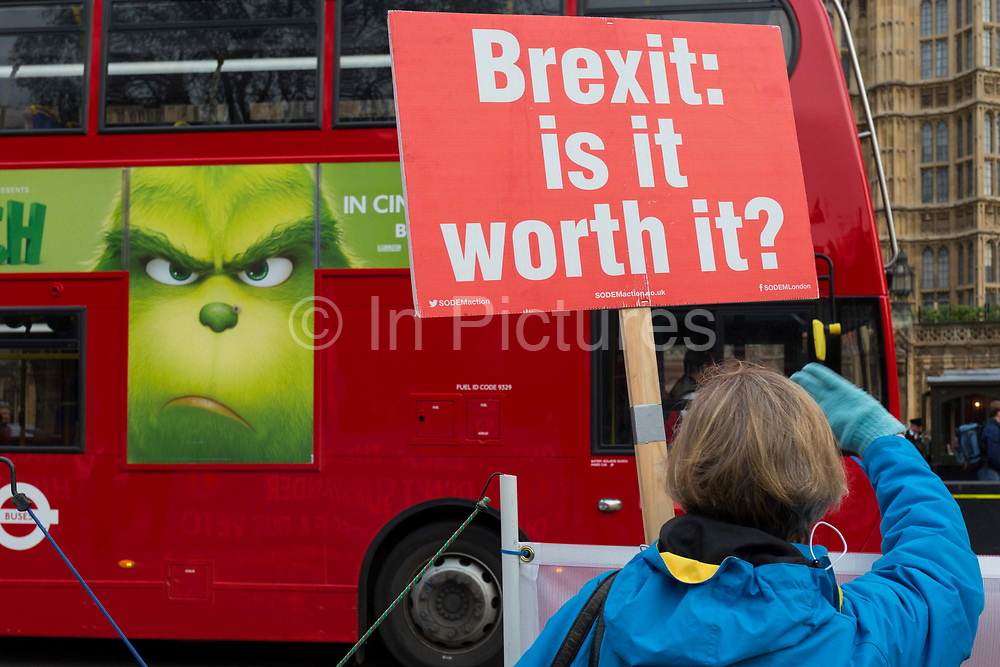 As Prime Minister Theresa May prepares to sell her Brexit deal ahead of five days of debate and eventual vote in parliament, pro-EU Remainers protest to passing motorists outside the House of Commons, on 4th December 2018, in London, England. This week will be a vital step for Mays Premiership and the UKs Brexit status.