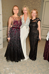Left to right, DINA KORZUN, EKATERINA FIELDS and ANNA DUROC-DANNER at the Gift of Life Old Russian New Year's Eve charity gala held at The Savoy Hotel, London on 13th January 2016.