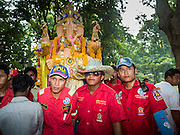 20 SEPTEMBER 2015 - SARIKA, NAKHON NAYOK, THAILAND:  Thai volunteers carry the Ganesha statue to the river at the Ganesh festival at Shri Utthayan Ganesha Temple in Sarika, Nakhon Nayok. Ganesh Chaturthi, also known as Vinayaka Chaturthi, is a Hindu festival dedicated to Lord Ganesh. Ganesh is the patron of arts and sciences, the deity of intellect and wisdom -- identified by his elephant head. The holiday is celebrated for 10 days. Wat Utthaya Ganesh in Nakhon Nayok province, is a Buddhist temple that venerates Ganesh, who is popular with Thai Buddhists. The temple draws both Buddhists and Hindus and celebrates the Ganesh holiday a week ahead of most other places.    PHOTO BY JACK KURTZ