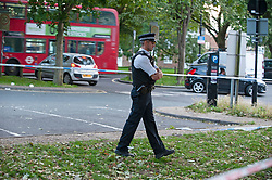 ©Licensed to London News Pictures 26/08/2020 New Addington,UK. Police at the scene. A 20 year old man is fighting for his life in hospital tonight after he was stabbed in New Addington, Croydon, South London. Local reports believe a machete was used in the attack. A police cordon is in place at the scene. Photo credit: Grant Falvey/LNP