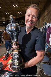 Sculptor Jeff Decker holding a bronze at the Mooneyes Yokohama Hot Rod & Custom Show. Yokohama, Japan. December 6, 2015.  Photography ©2015 Michael Lichter.