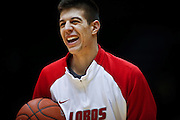 SHOT 2/23/10 8:45:59 PM - New Mexico's Roman Martinez cracks a smile while warming up with teammates at a pre-game shoot around before their regular season Mountain West Conference game against Colorado State at Moby Arena in Fort Collins, Co. New Mexico survived a tight game winning 72-66. (Photo by Marc Piscotty / © 2010)