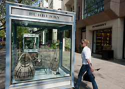 Luxury products on display in glass cabinets outside Burberry exclusive shop on Kurfurstendamm in Charlottenburg Berlin Germany