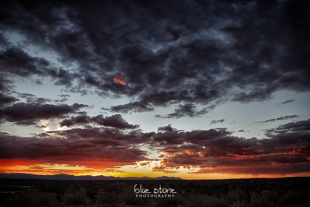 Spectacular southwest sunset during a thunderstorm with hues of gold, red and blue and silhouettes of distant mountains serves as nature's intervention for the soul.<br /> <br /> Wall art is available in metal, canvas, float wrap and standout. Art prints are available in lustre, glossy, matte and metallic finishes.