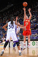 Iowa State guard Lyndsey Mendders (14) hits a three pointer over Kansas State's Shalee Lehning (5) and Shana Wheeler (30), during first half action at Bramlage Coliseum in Manhattan, Kansas, February 24, 2007.  Iowa State beat Kansas State 64-61.